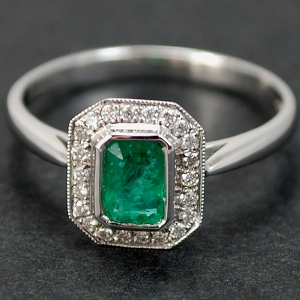 18ct White Gold Emerald and Diamond Halo Cluster Ring in Modern Jewellery from Coopers Jewellery, North Devon