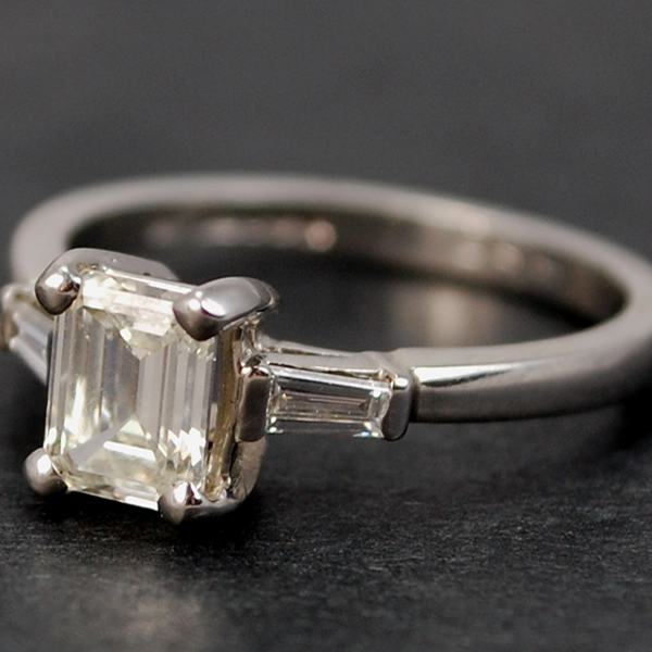 Platinum Emerald and Baguette Cut Diamond Ring in Modern Jewellery from Coopers Jewellery, North Devon