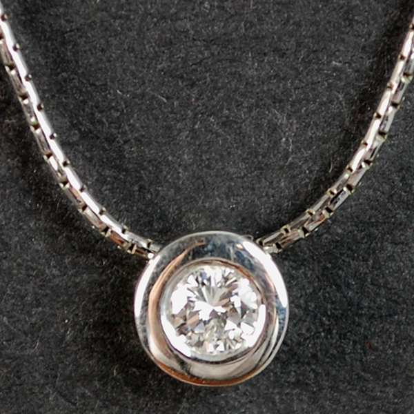 18ct White Gold Brilliant Cut Rub Over Set 0.25 Carat Diamond Pendant in Modern Jewellery from Coopers Jewellery, North Devon