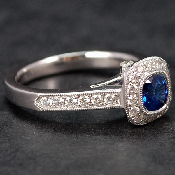 18ct White Gold Sapphire and Diamond Halo Ring in Modern Jewellery from Coopers Jewellery, North Devon